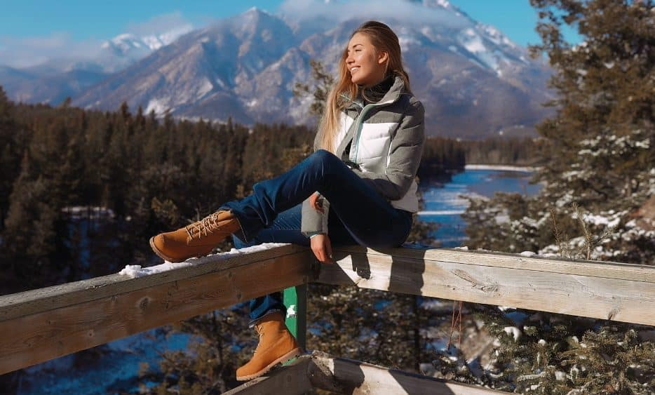 happy woman looking at mountains and beautiful scenery in Canada