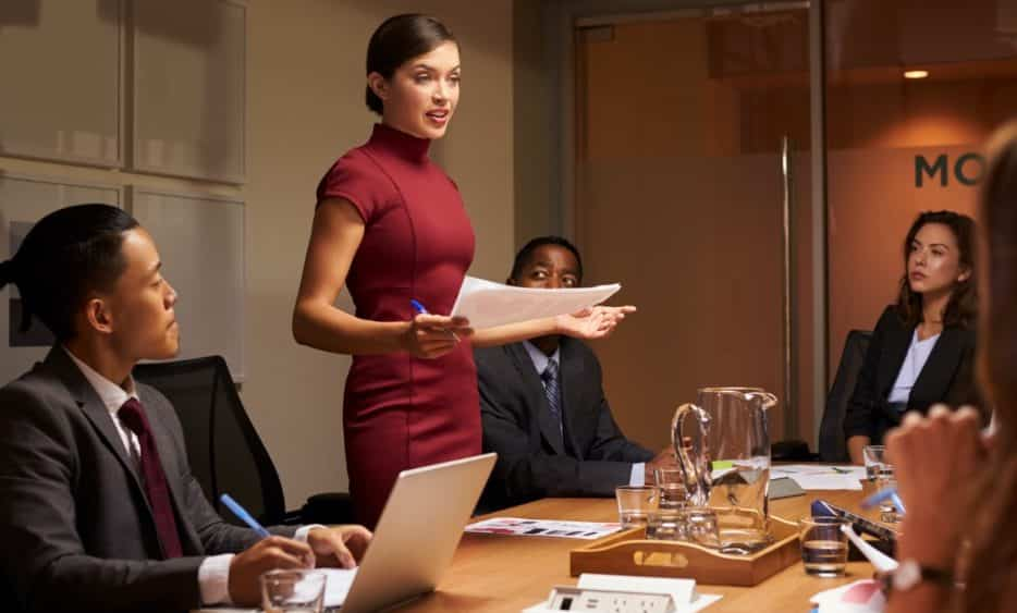 Female manager leading a team at a corporate office
