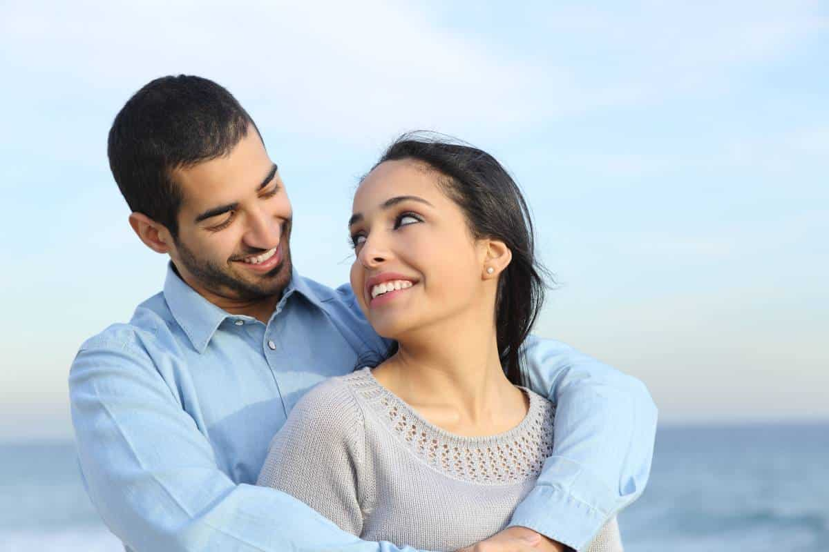 happy Arab couple holding eachother | immigrate to Canada from Lebanon
