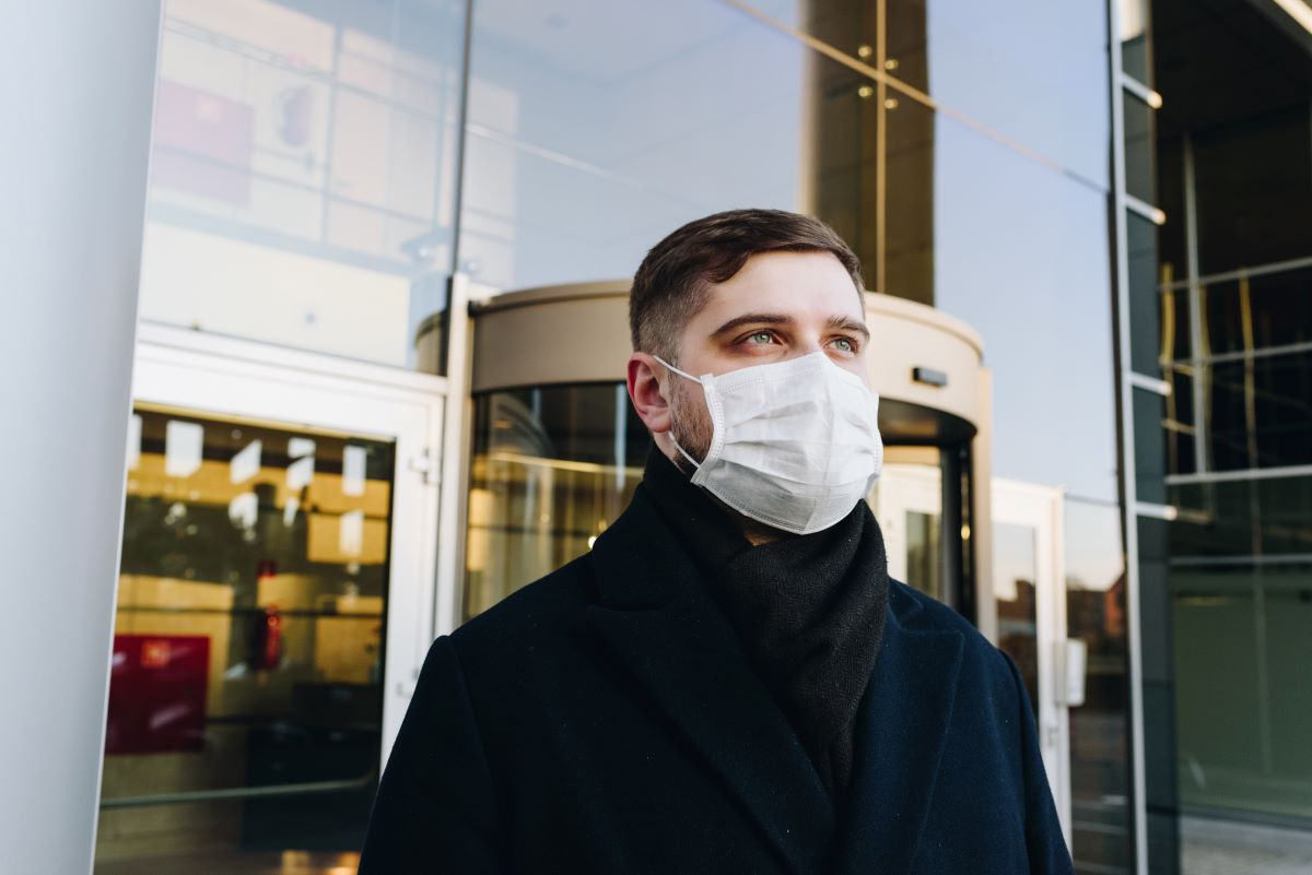 Man wearing a mask to protect himself from COVID-19