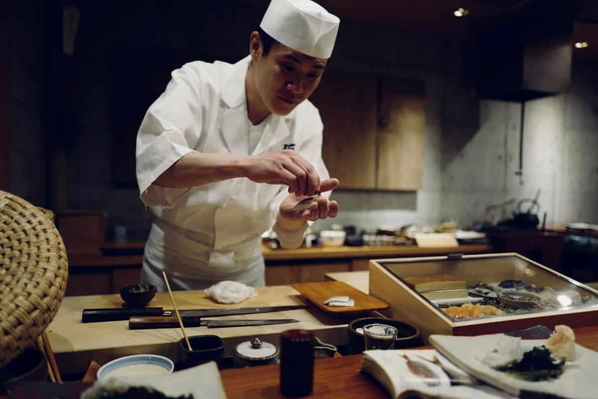 Sushi chef making sushi