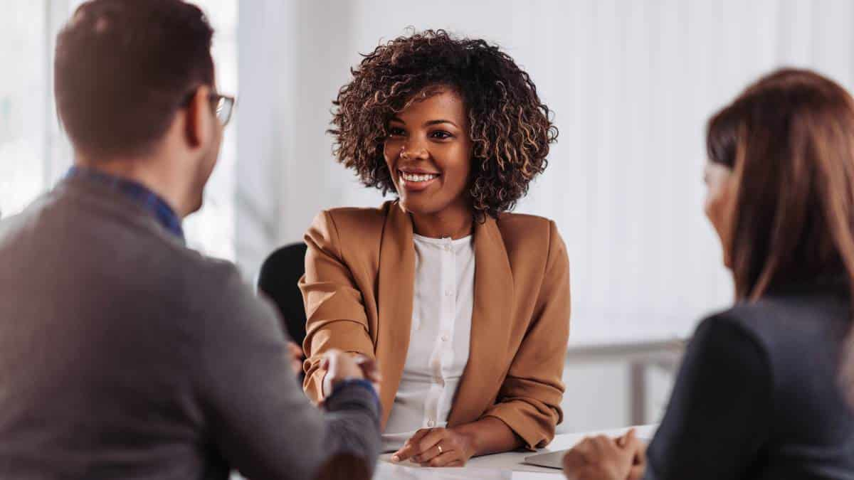 employers-shaking-hands-with-smiling-female-African-American-employee-at-interview | how to immigrate to Canada