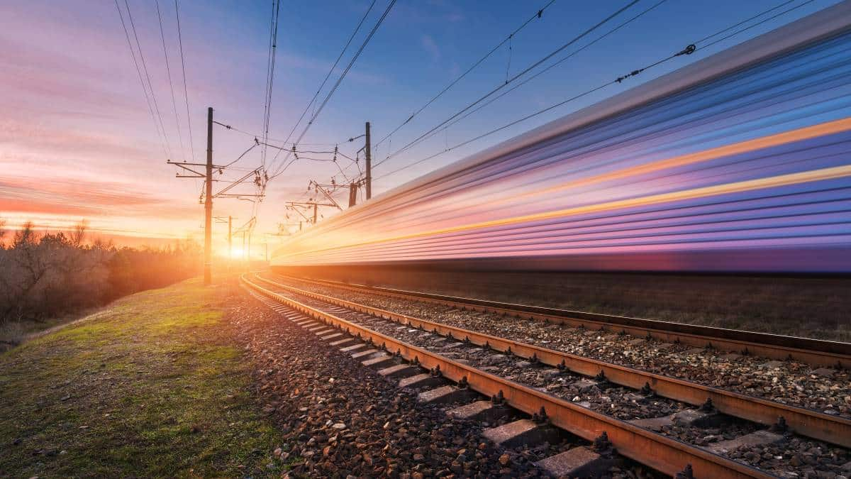 blurred-high-speed-train-in-motion-on-tracks-at-sunset | immigrate to Canada from India