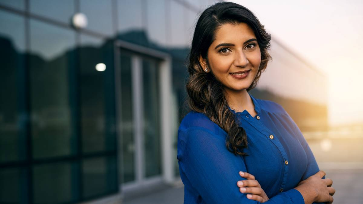 confident-smiling-indian-business-woman-with-arms-crossed | move to Canada