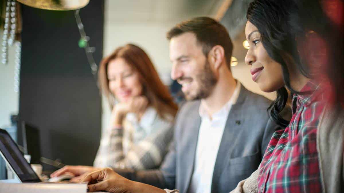 smiling-african-american-women-looking-at-computer-with-other-people   Canada Immigration CRS points