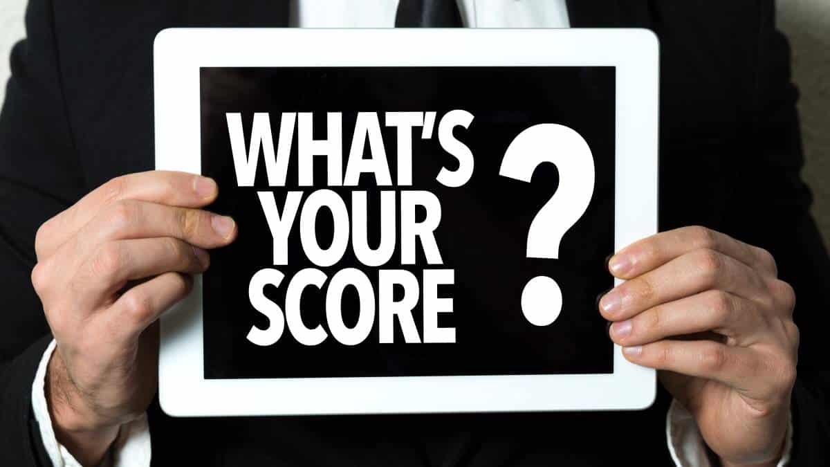 man-in-suit-holding-what-s-your-score-board   Canada immigration points system