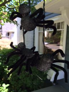 Finished tree spiders hanging from the trees to scare trick or treaters