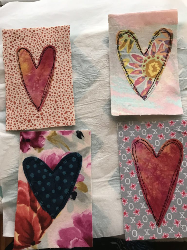 Hearts are sewn to the backgrounds