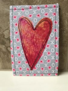 Big red heart on a lavender background
