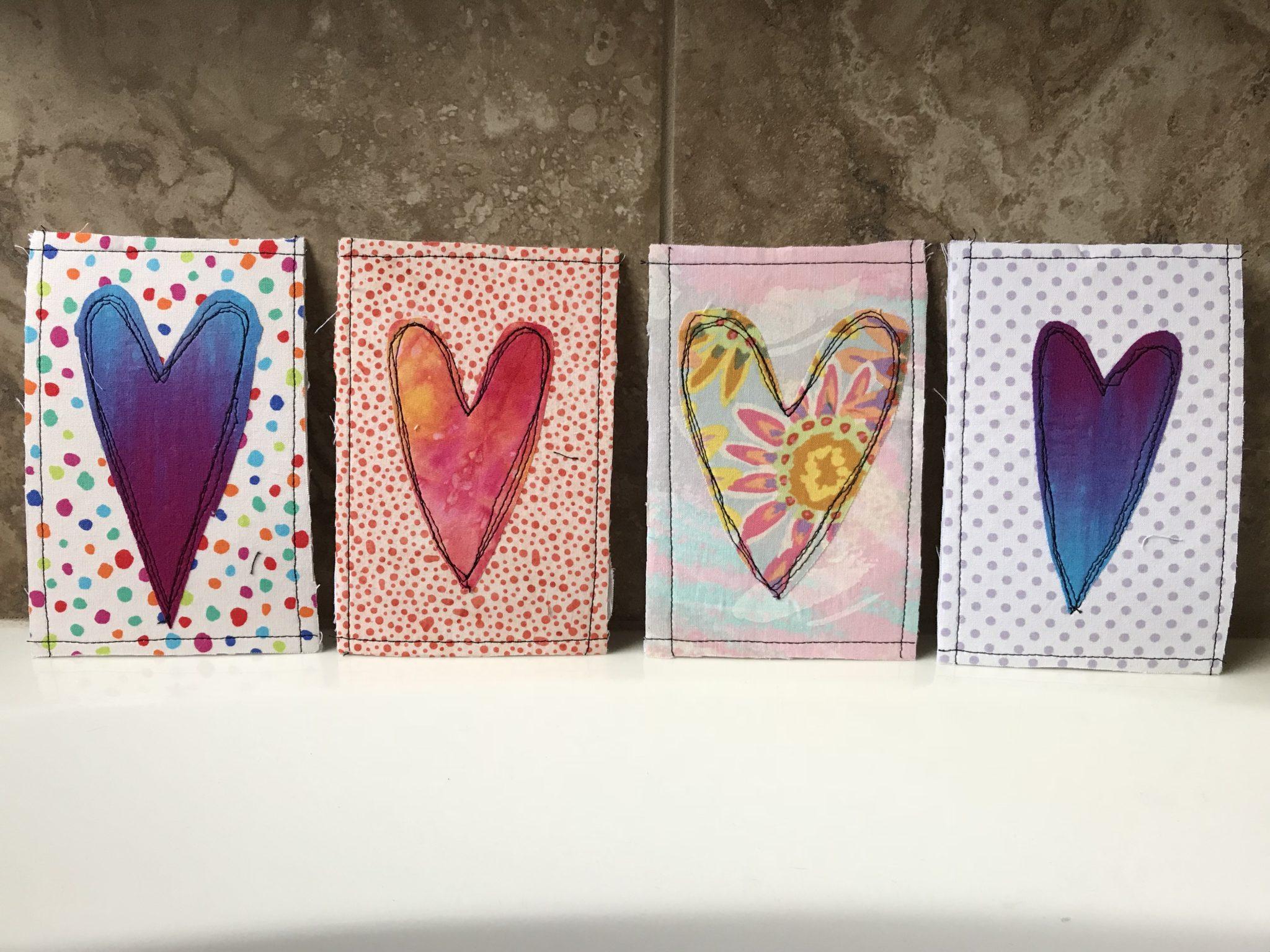 Four finished Valentine's postcards