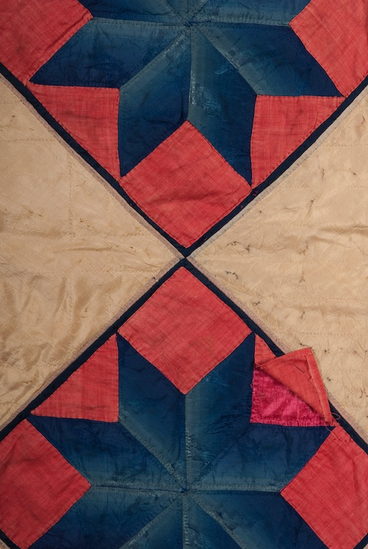 Close up of a vintage star silk quilt