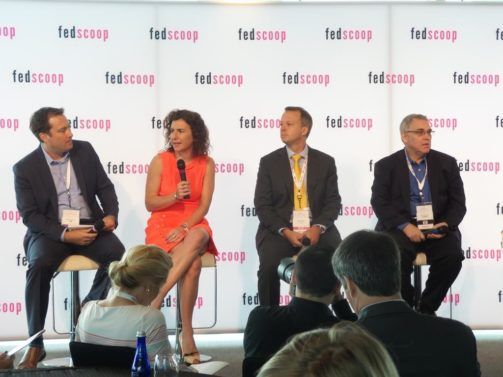 Bob Nicholson, from Dell Federal, moderates a cyber panel with Kiersten Todt, Thomas McDermott and Bob Gourley. (Source: Fedscoop)