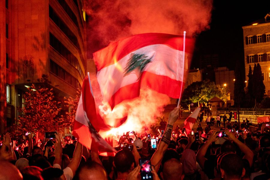 Popular protests target Lebanon's political system for the first time. Is it a revolution?