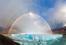 Gigante glaciar con doble arcoiris