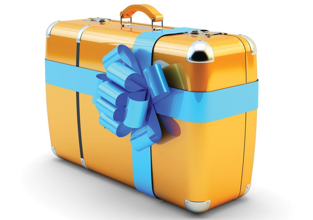 Maleta de viaje envuelta como regalo