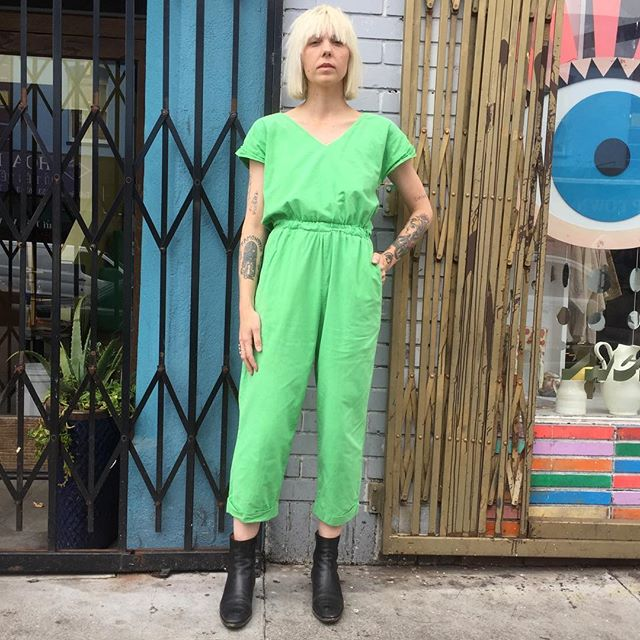 "VACATION - Make your own luck in this 🍀mint green onesie: you're gonna need it.  From Eber of San Francisco, 100% cotton (with stretch 24"" to 28"" waist); 40"" bust and a 23"" dropped-crotch inseam has custom tailored sewn-in cuffs at the ankle; two big pockets, finishes with a flirty tie at back.  March with long strides into YOUR future."