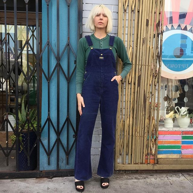 "VACATION - Take the Glam to the Farm in a pair of vintage 1970's #oshkoshbgosh navy blue corduroy union made sanforized  boot cut flare overalls!! These must be straight out of Joni Mitchell's closet!! This pair is in perfect condition!! The straps are adjustable, and they have the classic four leaf clover 🍀 buttons!! Nice big pockets in the front and back!! The waist measures 30"", and the inseam is 34""!! Wear them with your favorite pair of platforms or cut the hem for a super cool modern look!!"
