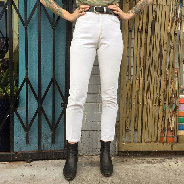 "VACATION - ""Stand tall, stand proud!"" ♀💓 Our brick and mortar location is mere blocks away from the largest protest in United States history, and we couldn't be more proud.  Come visit us at at 651 Larkin Street, and, while you're here, slip into these 1980's Michael G high rise tapered white jeans.  100% cotton.  Waist 25"", rise 11"", inseam 29""."