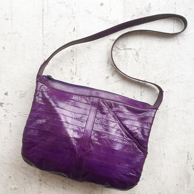 VACATION - 🍆 And here we present to you a gorgeous—HEY! Get your mind outta the gutter!  That's a PURPLE EEL and this is a promo for an ELECTRIC PURPLE EEL SKIN PURSE!  Some nerve—HUFF—this is a family business.  Luxurious vintage 1980s ten by eleven inch bag with thirty-two inch strap & tuff as nails diagonal slit pocket at top right.