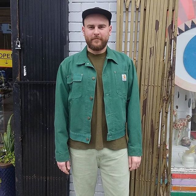 "VACATION - Emerald City #CARHARTT. green duck canvas jacket!! This rare vintage Carhartt jacket is a stunner!! This jacket is unlined for year round wear!! The cut is very 1960's (always a nice fit). You will literally never want to take it off!! CARHARTT is the workwear/counterculture phenomenon popular among grunge, punks, rap hip hop, and blue collar workers!! Size Medium:  The chest measures 22"", sleeves 25"", and length 24""."