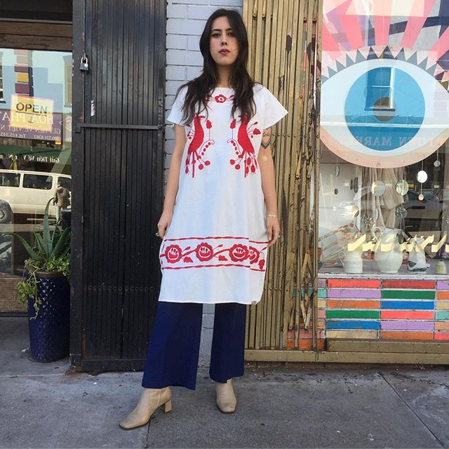 VACATION - The embroidered peasant dress is timeless!! Channel your inner 1970's bohemian babe vibes in this gorgeous linen embroidered dress!! This piece is perfect for layering or wearing alone!! It sure does pack a punch with wide-legged kick-flares or just with a pair of slides!! The embroidery on this dress is perfect!! The front and back have red peacock and flower detailing!! The nice sturdy linen against the vibrant red tone!! Perfect condition-open size up to a Large!!