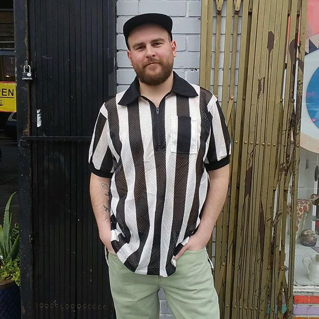 VACATION - Get your vocal cords ready for this one 🗣🗣 because you'll be shouting calls left and right in this awesome 👏👏 #REFEREE jersey!! This vintage black and white jersey has a nice collar and zips about five inches down the chest!! Wear it to a picnic or to the club!! Head's will be turning!! The jersey look is fresh!! Fit's Small/Medium!!