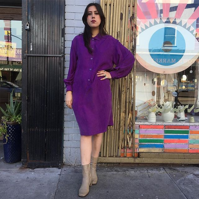 "VACATION - Popalotte, she wakes up on the longer city side.  Don't act; just curl up.  She doesn't need to find a place to hide.  Oversized thick silk that billows and drapes like haute couture is wont to do in 2017.  Matching purple and brass buttons with drop pockets enhance the effect.  Fits a M/L:  42"" bust, 22"" sleeves, 40"" length.  We are selling this."