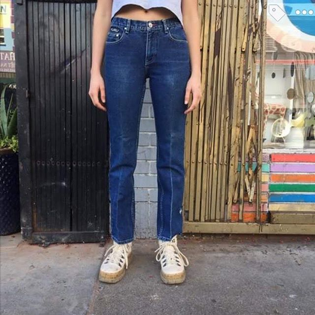 "VACATION - ""For Us, By US""- #FUBU !! Established in 1992, the ultimate jean is waiting for you!! This early 1990's pair has a beautiful dark wash with a perfect fade from wear. The waist measures 28"", rise 9"", and inseam 30""."