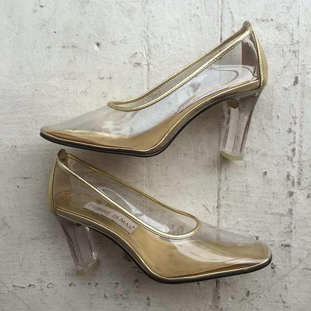 "VACATION - Sick AF #PIERREDUMAS Lucite and PVC modern Cinderella 👸 pumps!! The lining and back panel are gold 💰💰!! The heel measures 2 1/2"". These are a modern fairy tale shoe!! Great condition (like new)!!! Size 6.5M."