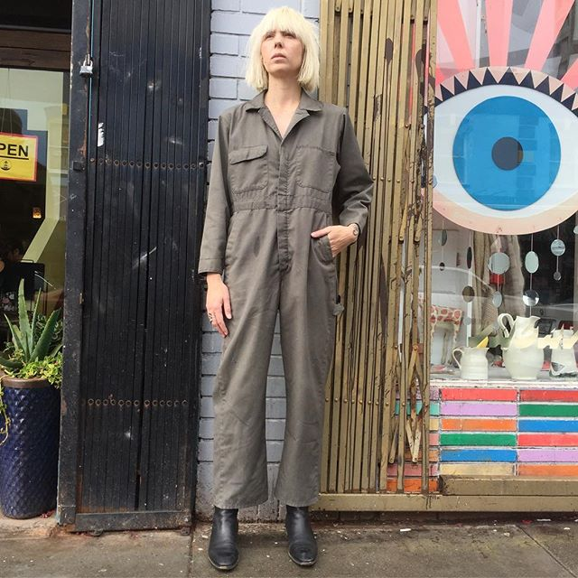 "VACATION - Is the future leaving you in the dust?  COVERALL your bases in this vintage olive colored BIG MAC jumpsuit.  Will fit up to and beyond a 34"" waist, but our model typically wears a 27"" and looks great; 27"" inseam; 44"" pit-to-pit.  Perfect amount of loving wear to rise up and out of the catacombs, destroying the machines of oppression 🤖 along the way."
