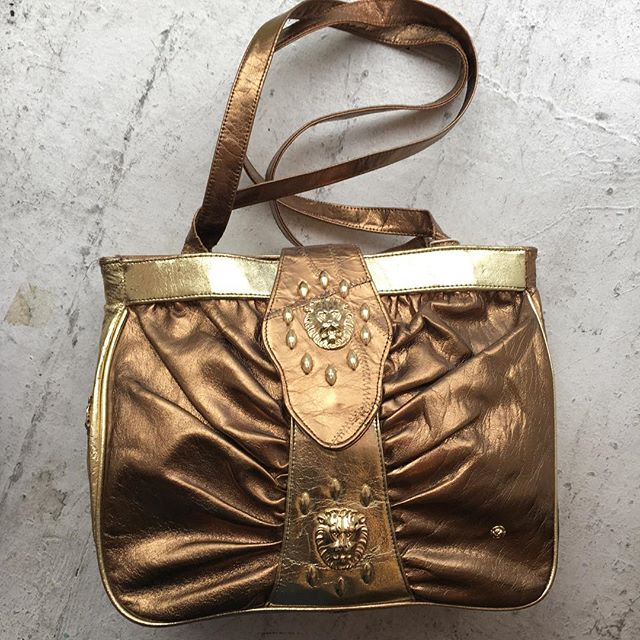 "VACATION - Two-tone Copper & Gold #Versace esque bag! Lion adornments throughout. Measures 11"" tall, 14"" across, 3"" deep, straps 16.5""."