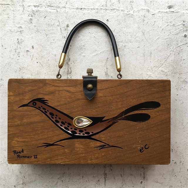 "VACATION - #roadrunner #roadrunner, you're going faster miles an hour. Come swing by the #stopandshop! Buy some shit and put it in this #1950s beautiful #enidcollins #folkart #americana bag. Handpainted and signed by the lady Enid herself. Box measures 11"" x 6"". Its large enough to hold a #modernlove, and the #moonlight. Buy one of these bad boys on the internet for more stars than there are in the desert sky- or grab a #speedy deal from us for"