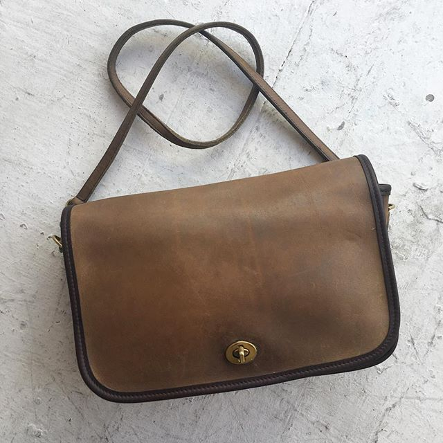 "VACATION - Late 70s #madeinnyc #madeinusa RARE #vintagecoach bag. Two tone tan and chocolate leather, take off the straps (with sick brass hardware) and you've got a clutch! 8x11"" with one interior zip pocket and one outside pocket."
