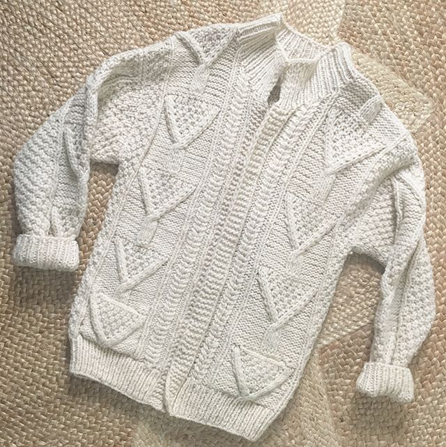 NORTH SOUTH EAST WEST - Vintage handknit zip front 100% wool cable knit fisherman's cardigan. It's the coziest thing on the planet. One size. A little roomie for a size small but works. Also good for boyfriends. It's in perfect condition.
