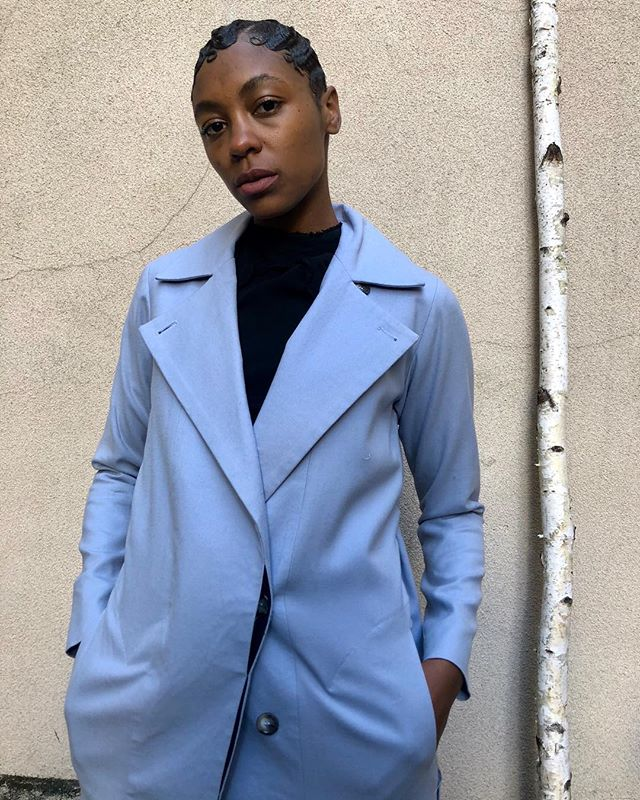 ReLove  - Powder blue Reformation trench coat. Belted tie to cinch the waist and a triple button closure down the front.