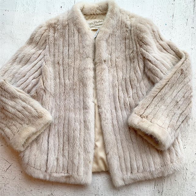 VACATION - The most beautiful ribbed #mink jacket- rare ivory mink, silk lined, original owner of this #vintagefur was 🥰Trudy🥰. Silk satin lined, pockets and a beautiful scallop hem. One of the best vintage furs we've had ❤️❤️best fits M