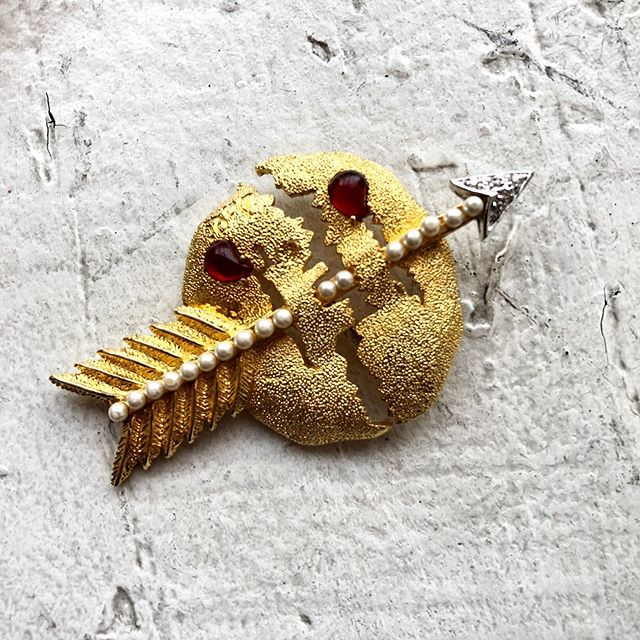 """VACATION - """"THE BLEEDING WORLD the suffering of the world divided by war and chaos. In the medal, born of war, the pearl arrow, holding the world together, symbolizes the love of Christ and the hope for peace"""" - DALI. From the dalijewels collection in Spain, a costume museum replicate."""