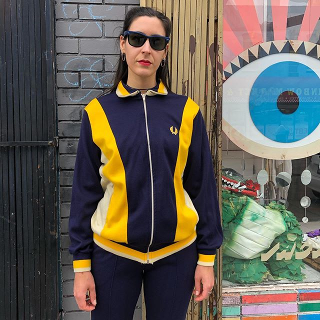 """VACATION - Oi mate! We're chuffed with this early 80s #FredPerry tracksuit  Marked size XL  Jacket measures 21"""" across the bust 27"""" sleeve length 27"""" long  Bottoms measure 13"""" across an elastic, stretchy waist 32"""" inseam 8"""" leg opening"""