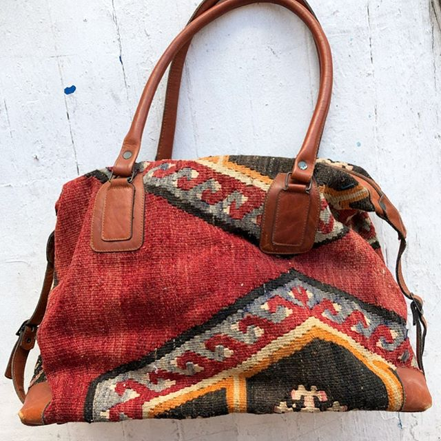 "VACATION - So good! XL #kilim weekender bag. Super well made, fully lined with velveteen. Amazing vintage condition, just a couple spots of wear in the kilim. Leather detailing, large zipper compartment with smaller zipper pocket inside. Perfect as a carryon. Measures 18"" x 14"" x 8"" with two 27"" leather handles."