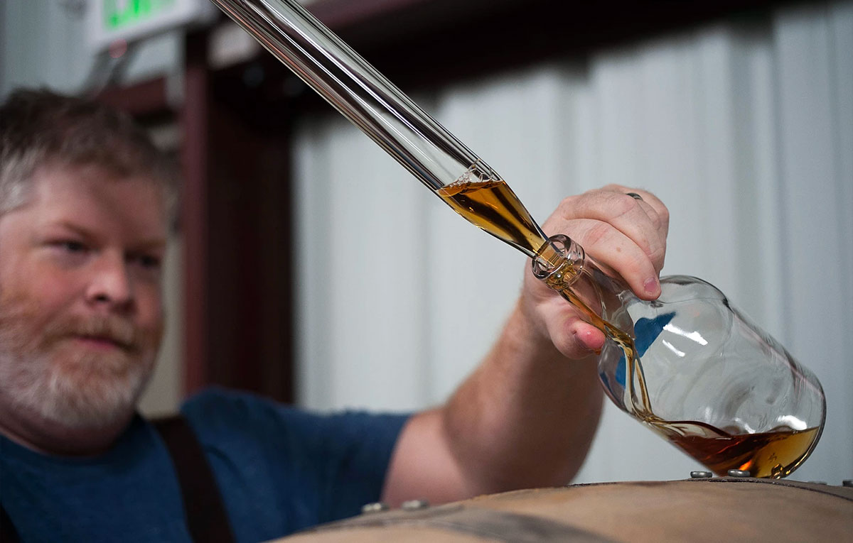 Leopold Bros: Sampling whiskey from the barrel