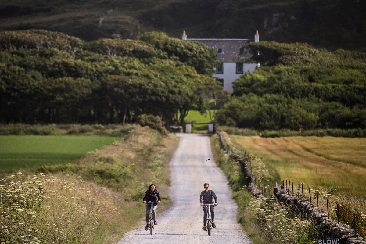 Visiting Islay: A couple bikes the rough roads leaving the Kilchoman Distillery