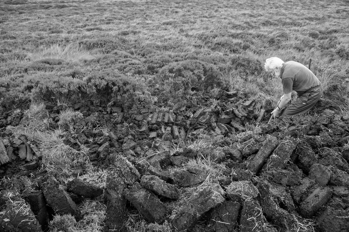 phenol count: Former Bruichladdich General Manager Duncan McGillivray cutting peat