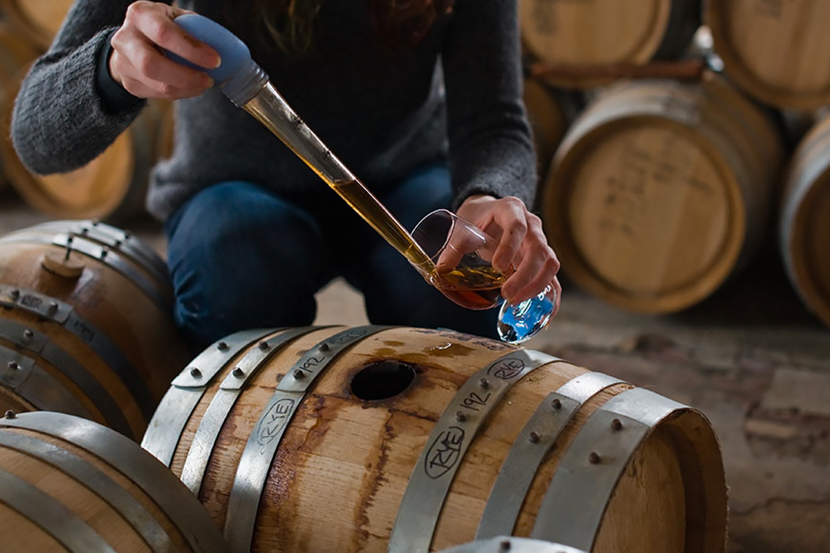 Empire Rye: Sampling from a barrel at Kings County Distillery