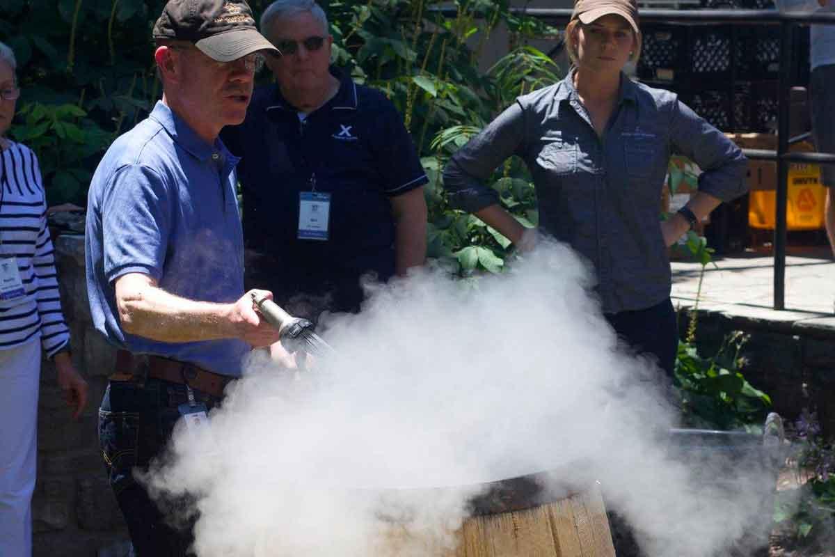 charred barrels: Woodford Reserve Master Distiller Chris Morris and barrels