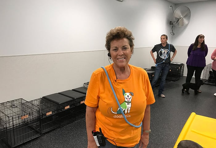 Canine Coach Diane, smiling at Dogtopia of Arcadia