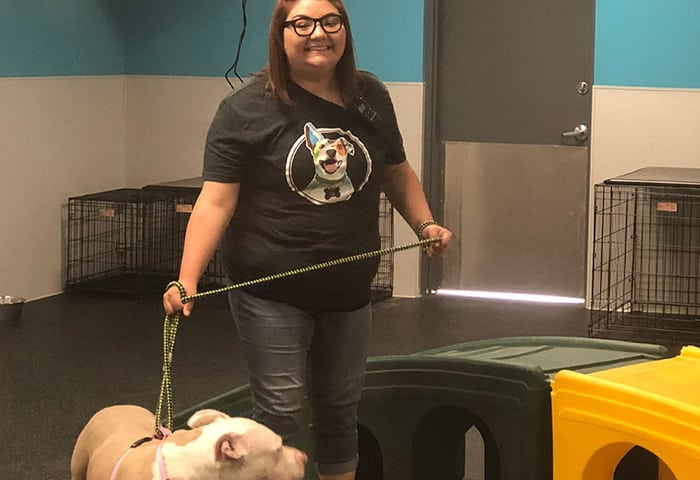 Canine Coach, Kate, holding dog on leash