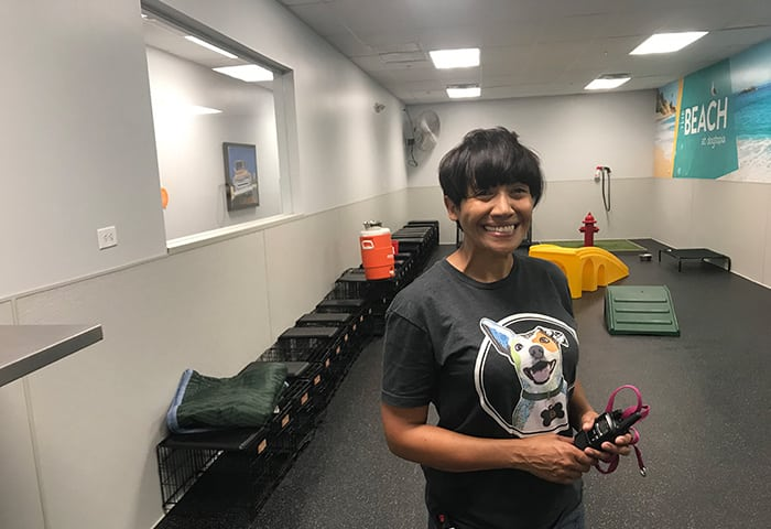Canine Coach, Inti, smiling holding walkie talkie