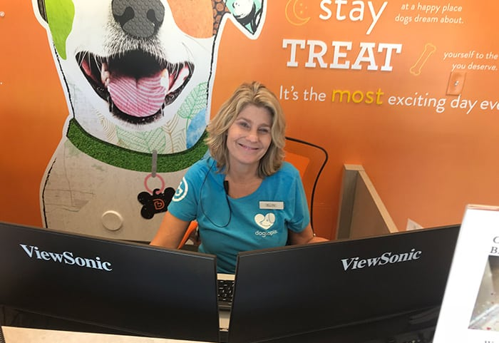 Ellyn sitting at the Front Desk at Dogtopia of Arcadia