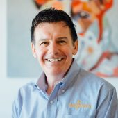 Neil Gill, CEO and President of Dogtopia Enterprises