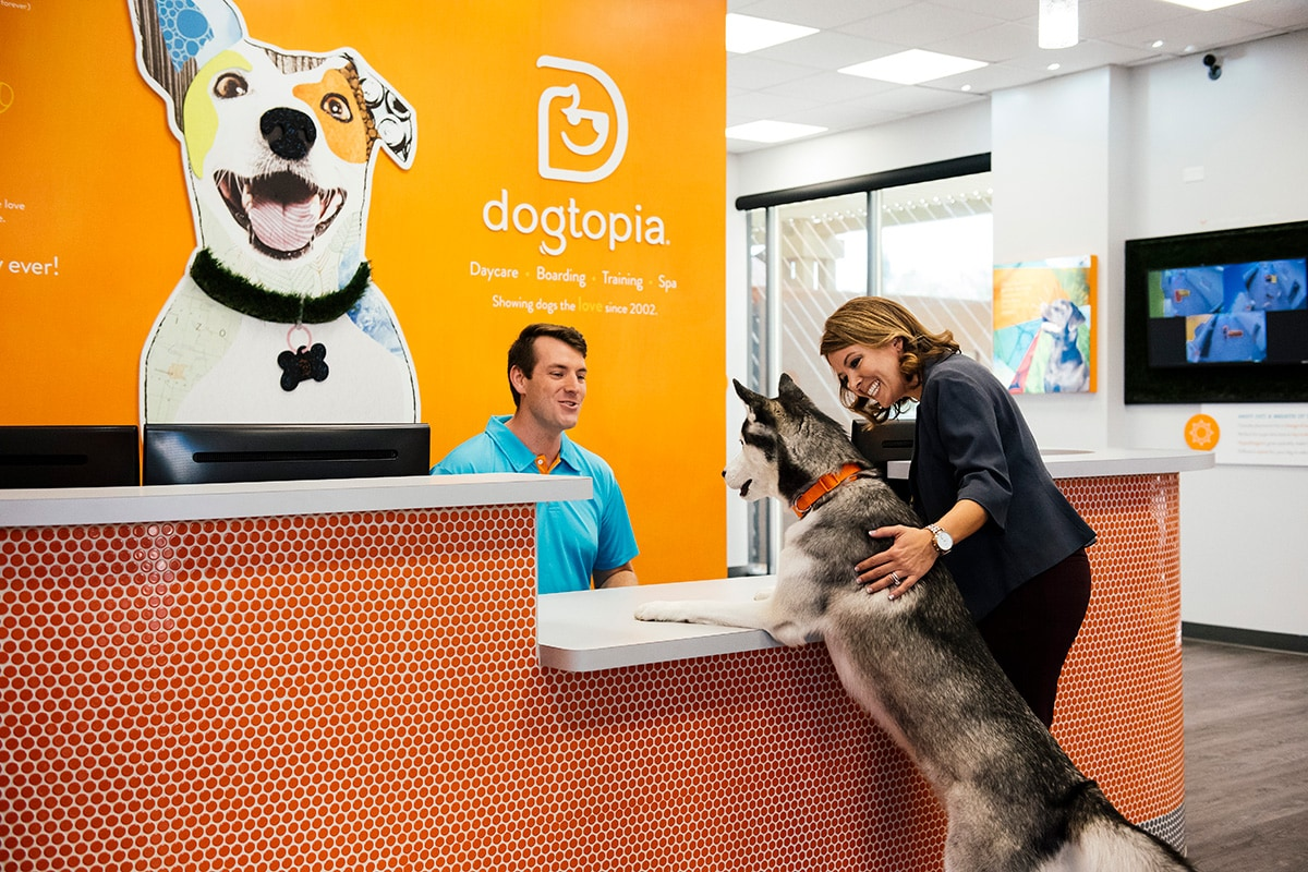 Owner and a dog standing in Dogtopia